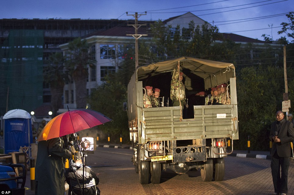 A truck of security forces arrives at the Westgate Mall after a bout of heavy gunfire just after dawn in Nairobi, Kenya Monday, Sept. 23, 2013.