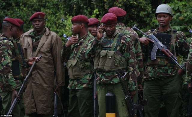 Kenyan policemen gather for a briefing near the Westgate Shopping Centre in the capital Nairobi, September 23, 2013. Heavy and sustained gunfire was heard from the Kenyan shopping mall on Monday morning