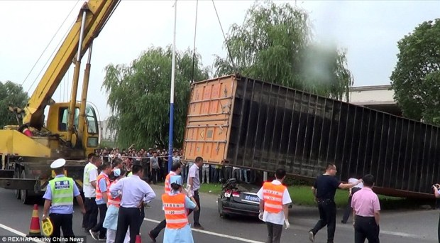 Rescue: Firefighters had to wait 20 minutes for a crane to arrive and remove the heavy container