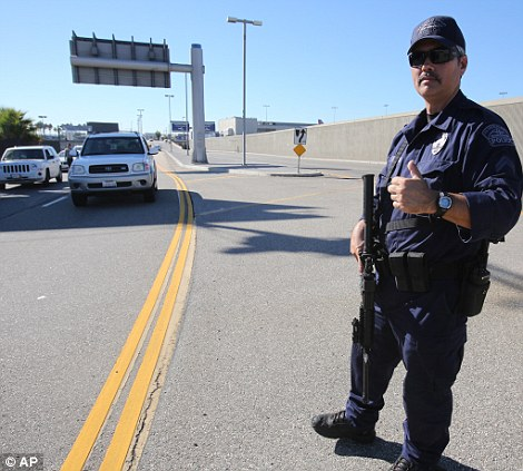 A police officer closes a road at the Los Angeles International Airport. Flights were suspended as the aiport was placed on lock down