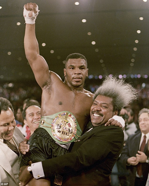Boxing promoter Don King lifts new the heavyweight champion after Tyson defeated Trevor Berbick in Las Vegas on November 22, 1986 - Tyson says Don King wreaked his life