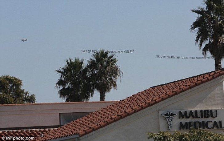 Grand gesture: The small plane carrying the message could be seen flying through the skies over Malibu