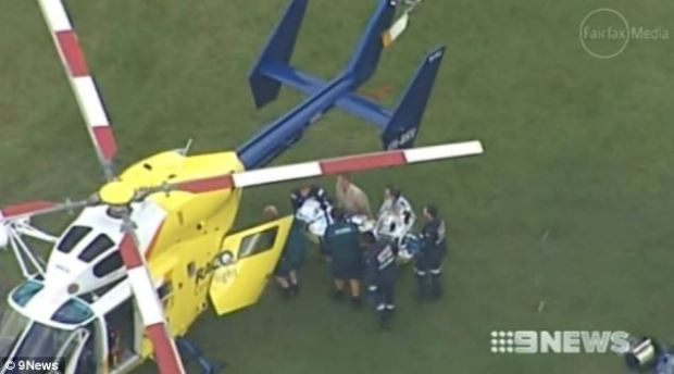 Emergency evacuation: Mr Styles is carefully loaded into a waiting air ambulance to be flown to hospital