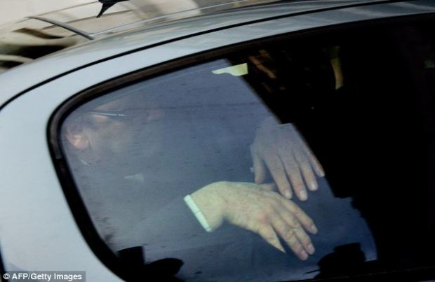 Court: Ms Kabou, 36, is here covered in the back of a car heading to court in Boulogne-sur-Mer, Northern France