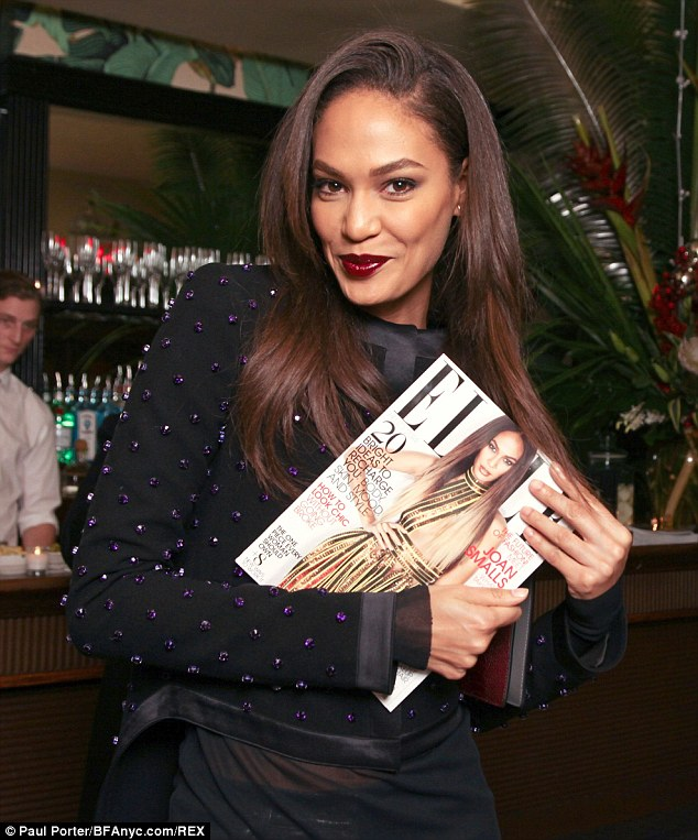 Cover girl! Joan proudly clutched a copy of her ELLE cover after dishing her beauty/fitness secrets in the magazine's October edition