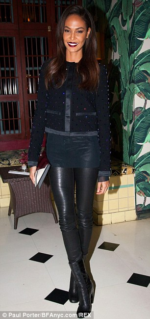 Woman of the hour: The 25-year-old model rocked tight leather trousers with a purple-beaded cardigan and black bootie heels