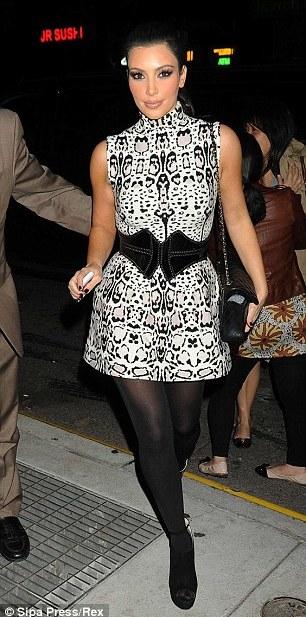 Little belters: Kate's plain jaket tones down her patterned mini dress