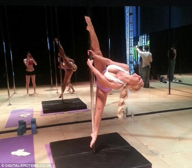 Stripper pole moves: The 34-year-old burlesque queen has been keeping herself in shape with stripper pole exercises