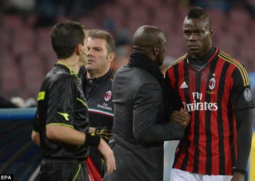 Distraught: Mario Balotelli (right) was visibly upset after being brought off by Milan boss Clarence Seedorf