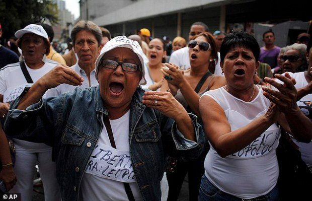 """Angry demonstrations: Women wearing homemade signs that read in Spanish; """"Freedom for Leopoldo,"""" shout slogans in support of opposition leader Leopoldo Lopez outside the Palace of Justice in Caracas, Venezuela"""