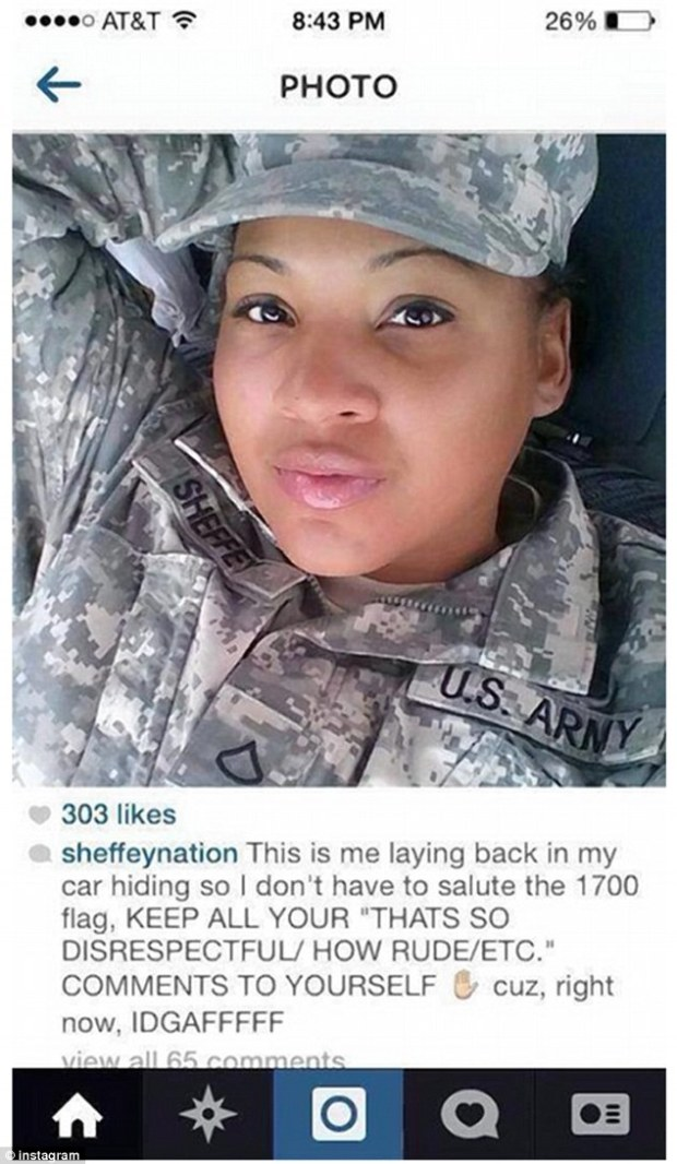 Backlash: Pfc. Tariqka Sheffey is under fire after she hid in her car to avoid saluting the flag and then boasted about it with a distasteful selfie, pictured, on Instagram