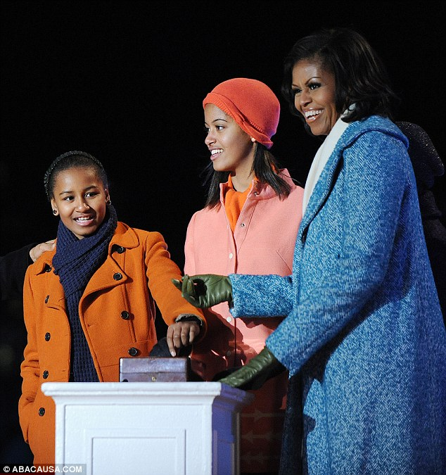 Far East: Michelle Obama and her daughters Sasha (left) and Malia (center) will travel to China this month
