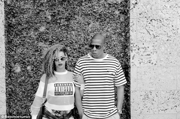Cool couple: Beyonce and her 44-year-old husband Jay-Z wore retro-styled sunglasses in front of a moss wall background in one of the snaps