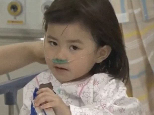 Lucky to be alive: Kwon Ji-yeon, 6, was pulled from the ferry on Wednesday