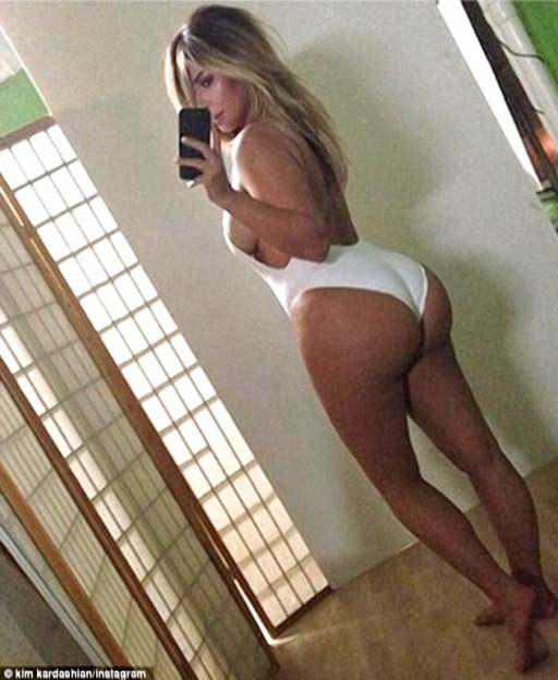 Baby got back: Kim Kardashian drew widespread attention when she posted this 'belfie' - a bottom selfie - onto her social media accounts, showing off her plump derriere