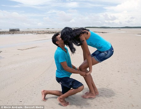 With well over a foot difference between their heights, Elisany and Francinaldo have more difficulty than most couples kissing after becoming engaged
