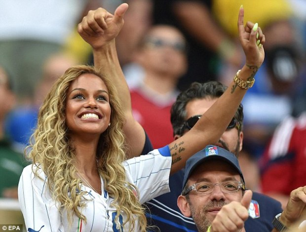 All smiles: Neguesha waves to the big screen at the Arena Amazonia during Italy's clash against England