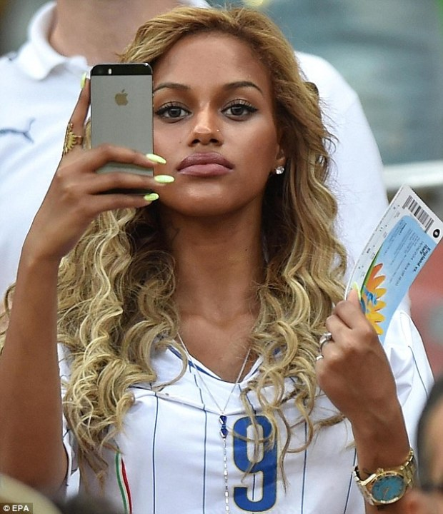 Say cheese: Neguesha soaks up the atmosphere in Manaus by taking pictures from her phone