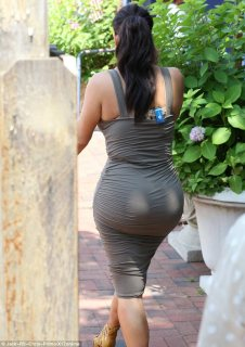 Just peachy: The frock showcased the reality star's hourglass figure, clinging to her famous derriere
