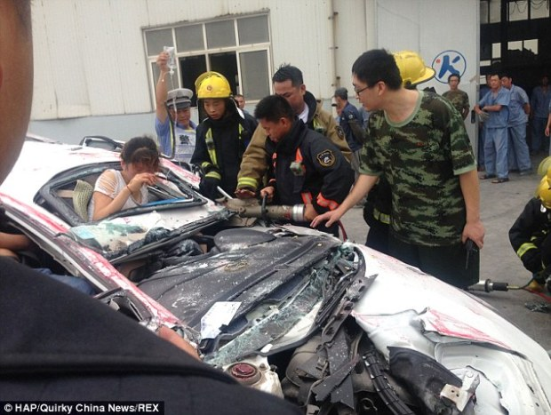 Dazed: Although the woman was not not badly injured she was taken to hospital to be treated for shock