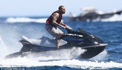 Go faster: The Look At Me Now singer enjoyed a jet boat ride too