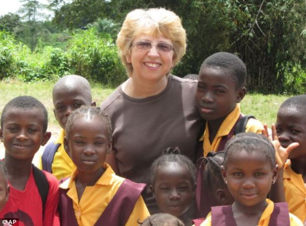 In hospital: Nancy Writebol, pictured with children in Liberia, worked for the charity Samaritan's Purse