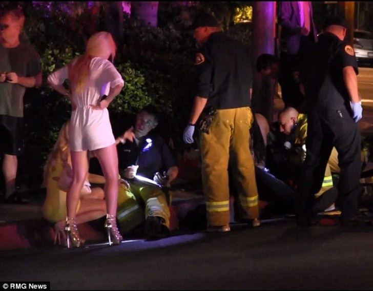 Witnesses: Partygoers talk to emergency personnel after the shooting