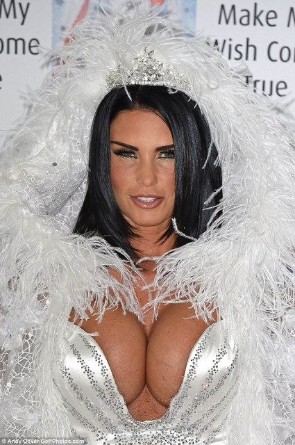 Made up: Katie was caked with make-up and her chest dusted with glitter