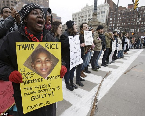 Protest: Activists took to the street in Cleveland, Ohio, on Tuesday after Tamir's death and compared his shooting to the killing of Michael Brown by officer Darren Wilson in Ferguson, Missouri.