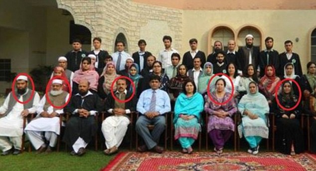 Gunned down and blown up: A photograph reportedly showing five of the teachers (circled) who died in the Pakistan massacre when Taliban gunmen and suicide bombers killed 148 children and staff at the school