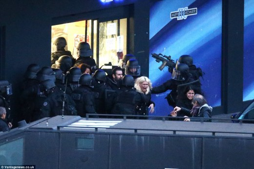 Terrified: Hostages - who had been held for hours with Coulibaly threatening to kill them - flee from the shop, crying with relief