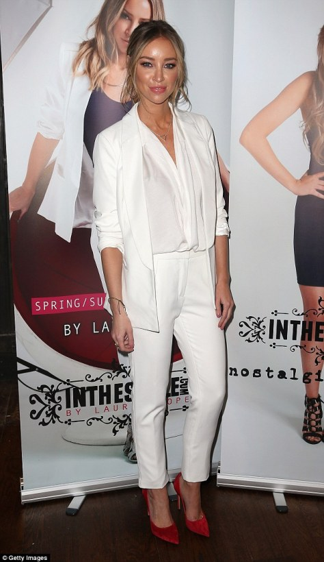 TOWIE star Lauren made sure to make a style statement in her white tailored suit, blouse and red court shoes