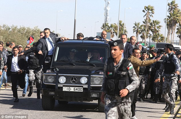 Return home: King Abdullah of Jordan arrives as Jordanians stand along the way between Amman and Queen Alia airport waiting to greet him upon his arrival on Wednesday