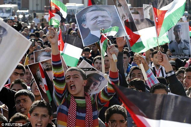Loyalty: Protesters made their support for Jordan's King Abdullah II clear during a rally in Amman today