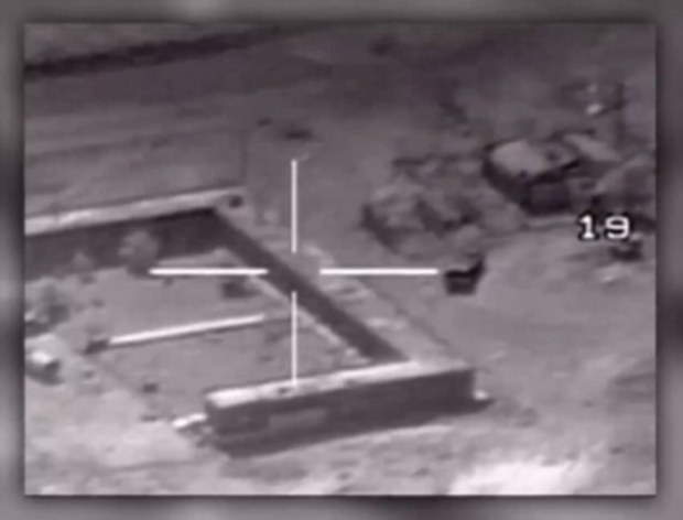 Target: Dozens of Jordanian fighter jets bombed ISIS training centers and weapons storage sites on Thursday. Above, aerial footage from the video released today appears to show a pilot seeking a target