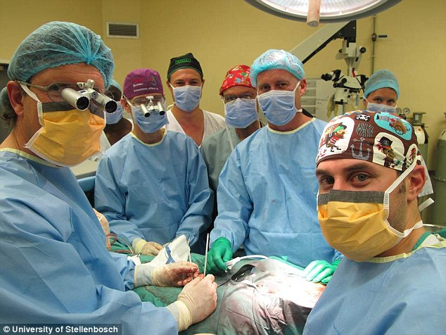 Six months after undergoing the world's first penis transplant, the 21-year-old South African man announced his girlfriend is pregnant. Pictured, are University of Stellenbosch surgeons during the procedure at Tygerberg Hospital in Cape Town, South Africa