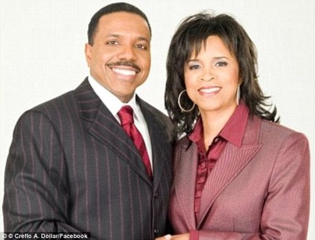 Couple: Rev Creflo Dollar and his wife Taffi. The couple have five children, two adopted, three biological, and live on a 53-acre estate close to Atlanta. He has a penchant for pinstrip suits