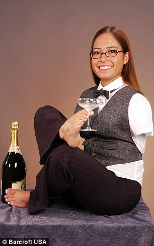 holding a glass of champagne in 2005