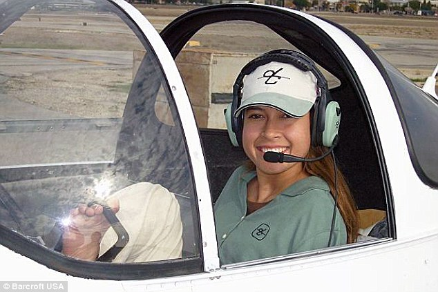 Happy days: A smiling Jessica inside a plane in 2013 after gaining her pilot's licence in 2008