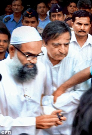Yakub's brothers Suleiman (left) and Usman pictured outside the jail in Nagpur