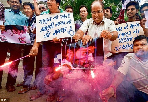 People celebrate after the hanging of 1993 Mumbai blasts accused Yakub Memon, in Ahmedabad