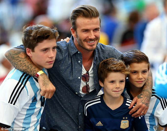 David, with his sons Brooklyn (left), Cruz (centre) and Romeo (right) in Brazil, in July 2013.One suggestion is that the couple could move the whole family back to Los Angeles in an attempt to rekindle their marriage