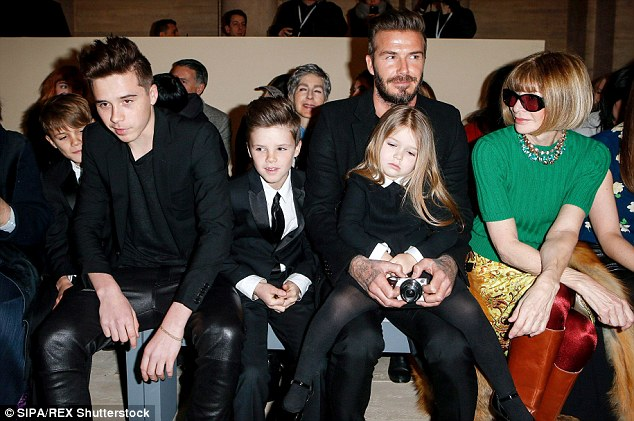 All together: (from left) Romeo, Brooklyn, Cruz and Harper with David Beckham and Anna Wintour during Victoria's show at New York Fashion Week, in February this year. After David retired from football in 2013,Victoria felt it was 'her turn' to be in the spotlight and that David ought to be content with the role of a house husband