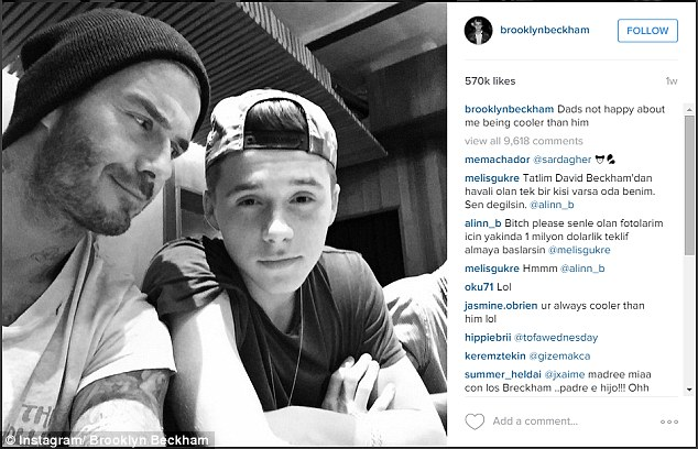 Family snap: David and Brooklyn Beckham, as the pair enjoyed David's new role as house husband while Victoria stepped up her work