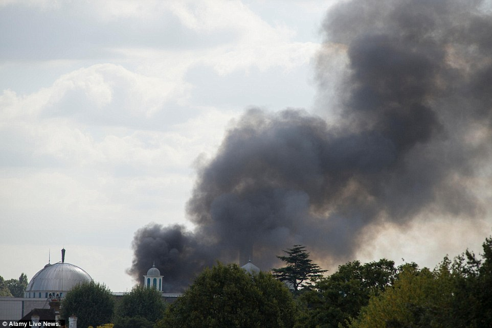 Plumes: Smoke could be seen rolling into the sky from miles away as the mosque was consumed by flames