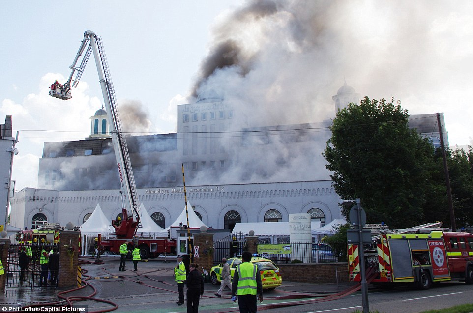 Ornate: The mosque's archways and spires were scarcely visible behind the smoke caused by the blaze