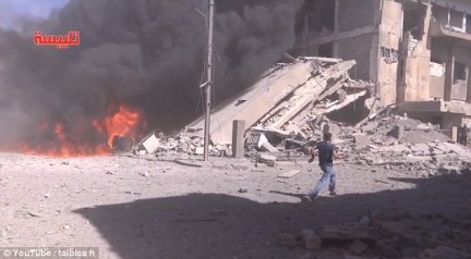 A Western-backed Syrian rebel group confirmed that at least one of its leading officers had been killed in the airstrikes in the central Homs province. Pictured: Footage from the ground in Syria after rockets hit Homs