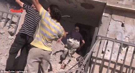 Blast: Locals run for cover as Russian airstrikes target three areas of Syria, although not ISIS-held territory