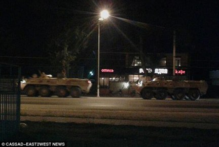 Under the cover of darkness: A picture emerged today purporting to show heavy Russian military equipment in desert camouflage being sent from Novorossiysk port in southern Russia to Syria