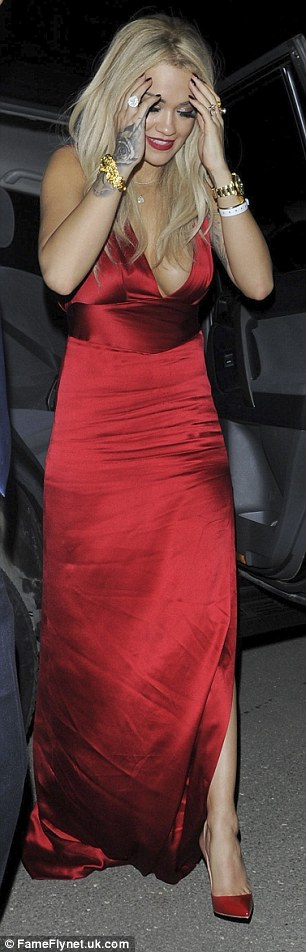 Bringing sexy back: Rita's satin gown also featured an open back which revealed her delicate tattoos